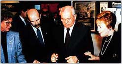 Mikhail Gorbachev signs the guestbook before his tour of the Winston Churchill Memorial.