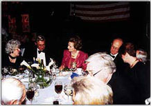 Lady Thatcher converses with Sue Young and John Marsh during the black-tie dinner held in Thatcher's honor.